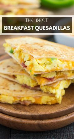 These Easy Breakfast Quesadillas are filled with fluffy, scrambled eggs, green peppers, bacon and cheddar cheeses, all enveloped between two crispy tortilla shells. It's an easy meal that's perfect for busy mornings! #quesadillas #breakfastquesadilla #eggs #breakfast #quesadillarecipes #easybreakfast #breakfastrecipes #recipe Healthy Breakfast Desayunos, Egg Recipes For Breakfast, Breakfast Dishes, Dinner Recipes, Apple Breakfast, Quick And Easy Breakfast, Breakfast Casserole, Breakfast Wraps, Healthy Breakfasts