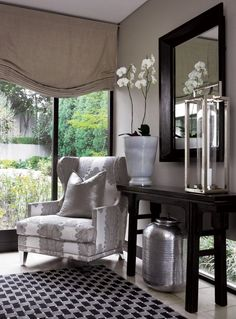 Elegance in neutral tones . . . the black console and mirror are statement pieces in their own right but in this instance harmonise  well with the sophisticated backdrop of silver, taupe and grey #decor and accesories . . .