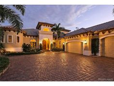 Traditional Mediterranean Naples Florida Home - corbels, paver driveway.  Olde Cypress, Naples Florida