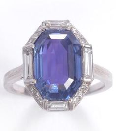 AN ART DECO SAPPHIRE AND DIAMOND RING, LUIS SANZ, SPANISH, 1920s. Set with an octagonal sapphire within similarly-shaped borders alternately set with baguette and single-cut diamonds, signed Luis Sanz, Madrid and numbered. #LuisSanz #ArtDeco #ring