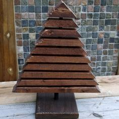 rustic Christmas tree decoration (cut a triangle 2x10 and slice!)  LOVE THIS TREE!