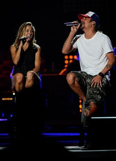 Kid Rock Photos Photos - Singers Sheryl Crow and Kid Rock perform onstage during Day 1 of rehearsals for the 2011 CMT Music Awards at Bridgestone Arena on June 7, 2011 in Nashville, Tennessee. - 2011 CMT Music Awards - Rehearsals - Day 1