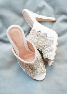 Alessia Bridal Shoe - Emmy London A super sexy bridal mule with skyscraper heel. Decadent hand beading with pacific opal stones adorns the front of the Alessia. Perfect for the modern fashion forward bride.  The gorgeous Alessia bridal shoe is the show-stopper of our Cancello collection, inspired by the architectural geometric patterns of Italian metal work. The intricate detail and super high, sexy shapes make these bridal mules perfect for the modern bride who wants shoes with wow factor.