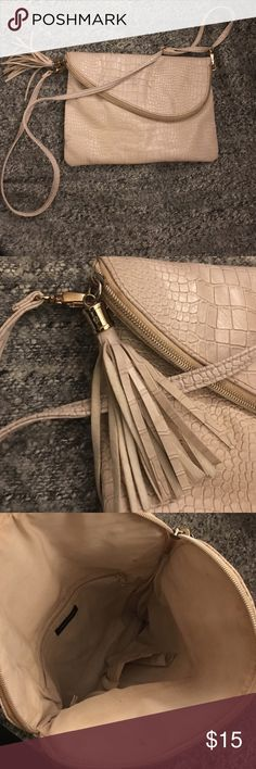 Cross body purse Can be turned into a clutch or a crossbody. Beige faux snake skin! Gold zipper. Inside shows sign of wear & back ( THIS PRICE IS NOT NEGOTIABLE ) atmosphere Bags Clutches & Wristlets