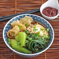 Spicy Korean Ramen Noodle Soup - this hearty Asian noodle soup is a one bowl meal, with dumplings and veggies too ~ http://jeanetteshealthyliving.com