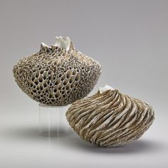 """ANNE GOLDMAN Two vessels, """"Stone Flower"""" and """"First Snow,"""" California, 1990s; Carved and sculpted stoneware with porcelain and iron slips;"""