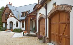 Tudor Style House with brown wood accents on a white house.