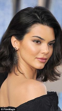 Girl next door: Kendall Jenner, 21, stunned in a black minidress and natural-looking make-up