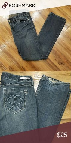 "Express Jeans Comfortable dark denim material (98% cotton,  2% spandex) with silver/gray stitching.  Frayed and faded at back ankle hems. Neat back pocket design. Size 8r, 32"" inseam Express Jeans"