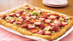 Strawberry-Kiwi-Almond Tart - Transform refrigerated crescent rolls into a fantastic dessert loaded with almond and fruit flavours.