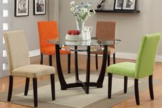 Dinette Sets With Colored Chairs - It is really a popular trend to mix and match your dining room table along with your dinin Dining Table Set Designs, Glass Round Dining Table, Dining Room Design, Round Glass, Glass Tables, Colored Dining Chairs, Fabric Dining Chairs, Dining Room Furniture Sets, Dining Room Table
