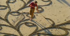 A Man Takes A Single Rake to The Beach. And When You Zoom Out And See It… Mind BLOWN.