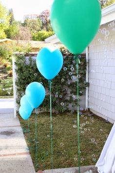 under the sea little mermaid first birthday party balloons and bubbles at entry way