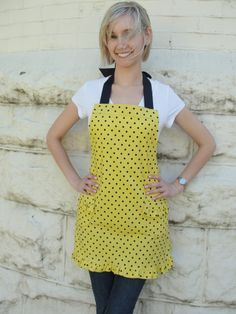 Yellow with black dots and ruffle trim around skirt. www.etsy.com/shop/overthetopaprons