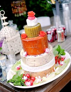 A cake of delicious cheeses - chosen by the bride and groom from the local deli counter - topped off with a 'babybel'
