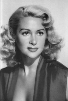 MARTINE CAROL (1920-1967) was a French film actress. She studied acting under René Simon, making her stage début in 1940 and her 1st film in 1943. She was frequently cast as an elegant blonde seductress. During the late 1940s & early 1950s she was the leading sex symbol and a top box office draw of French cinema. One of her most famous roles was in Lola Montès, a role which necessitated dark hair. However, by the late-1950s, roles  had become fewer, due to newcomer Brigitte Bardot.