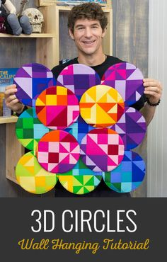 Rob demonstrates how to make an amazing 3D Circle Quilt using ColorWorks Concepts - Phase II Cosmopolitan Blue Multi Panel, a circle rotary cutter compass, Cotton Couture solids by Michael Miller, an edge guide or seam guide sewing machine attachment, a lapel stick, and Bosal Foam.