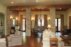 Love the wood beams and the brick columns!