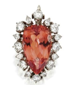 Platinum, diamond and orange topaz pendant brooch.