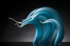 Florida-based sculptor Rick Eggertproduces glass works that are often displayed as groups, each individual sculpture adding to a collective warm or cool gradient.