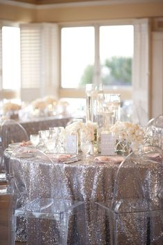 Silver and blush are such a chic combination for a wedding! | Glittering table linens & lucite chairs