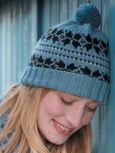 Snowflake Hat by Martin Storey free download (after registration) on KnitRowan.com at http://www.knitrowan.com/designs-and-patterns/patterns/snowflake-hat