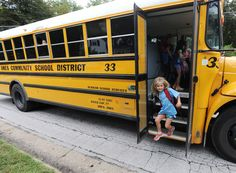 Meredith Frandsen, a student at Edwards Elementary School, gets off of the school bus after school on Friday in Ames. The school district has recently revisited the bus schedule after weeks of issues with late arrivals and missed stops. Photo by Nirmalendu Majumdar/Ames Tribune