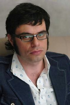 Jemaine staring the camera down with that collar and those lapels reminds me of Charles Bronson.