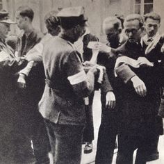 First days of August 1944, Warsaw, new recruits get white-red armbands  From Dni Powstania