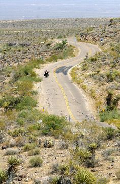 A lone motorcycle rider travels on historic Route 66 across the western Arizona desert on the approach to Oatman, AZ, 12 July 2003. Route 66, 2,448 miles (3,939 km) of two-lane highway, was once the main artery between Chicago to Los Angeles.