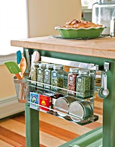 Island organization  Add a hanging shelf to your kitchen island for easy-to-reach storage of spices, utensils and measuring spoons.