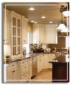 This is exactly the kitchen I would choose!!! I LOVE the ivory cabinets with the glazing!!!!
