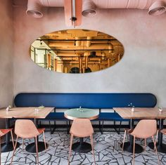 A photogenic palette of warm golds, rich blues, and a dusty pink patina give this Moscow café the influencers' seal of approval... #restaurantdesign