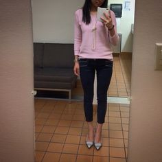 Pink sweater and pearl necklace