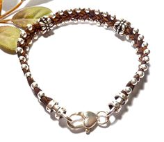 Braided Leather and Sterling Silver Beaded Bracelet, and Two Flower-like Beads- Jewelry by Leandra (Sterling Duo).