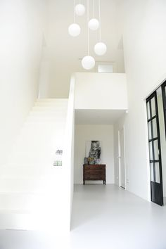 Love this combination of white, black, old modern!