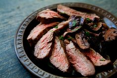 Grilled Flank Steak with Mushrooms Recipe Main Dishes with flank steak, salt, olive oil, black pepper, mixed mushrooms, butter, shallots, red wine, fresh rosemary