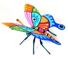 This beautiful mariposa, butterfly, is an Oaxacan wood carving by Luis Pablo.
