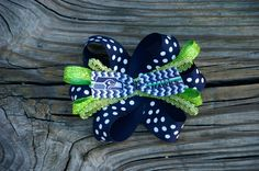 A personal favorite from my Etsy shop https://www.etsy.com/listing/219202364/seattle-seahawks-glitter-hairbow-clip