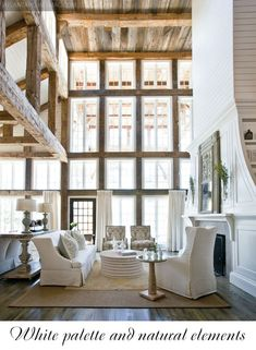 White and Wood Lounge - stunning with high ceilings and neutral/white with wood finishes.