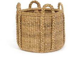 SWEATER WEAVE FIREPLACE BASKET is made up of palm leaves braided into a tight pattern with rattan framing for maximum support. Look closely and you'll instantly think of that favorite cable cardigan.