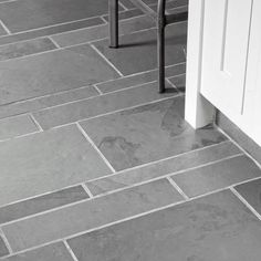 Interesting slate-tile floor layout in the kitchen of remodeled Craftsman. Photo: Lisa Romerein | thisoldhouse.com