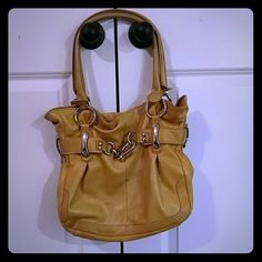 B.Makowsky Yellow Leather Purse B.Makowsky yellow leather purse. Pre owned. Very soft leather and clean interior. Does have a mark on the front. You can see in pictures. b. makowsky Bags Shoulder Bags