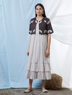 Off White Double Frilled Cotton Dress with Brown Clamp Dye Shrug- Set of 2 Simple Dresses, Casual Dresses For Women, Clothes For Women, Kurta Designs Women, Blouse Designs, Indian Designer Outfits, Designer Dresses, Linen Dresses, Cotton Dresses