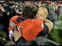 Georgia head coach Mark Richt celebrates the team's win over Auburn with center David Andrews.