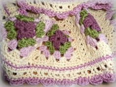 This Beautiful and Soft HANDMADE CROCHETED BABY BLANKET/ AFGHAN made of a variation of a traditional granny squares pattern . The colors I choose are - dark rose center, olive green, dusty rose and a cream or sand color for a base. Blocks are done separately and then connected together with a special stitch into beautiful blanket and edges are adorned in dusty rose yarn waves to create a finished look. This afghan is - 33 x 34 , perfect size for baby cribs, car seats, strollers or t...
