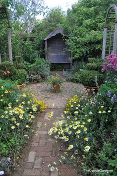 The Artisan's Cottage Garden... looooove the garden path ending in circular area and of course the whole incredible garden setting!!!!