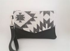 Hey, I found this really awesome Etsy listing at https://www.etsy.com/listing/493605629/aztec-wristlet-vegan-leather-trim