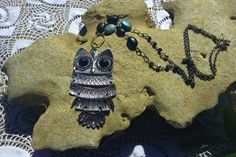 bohemian chic vintage owl pendant on a hand wrapped chain with turquoise and black beads