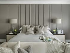 Bespoke upholstered wall, headboard, upholstered panels, Superking-size bed, sofa at foot of bed,
